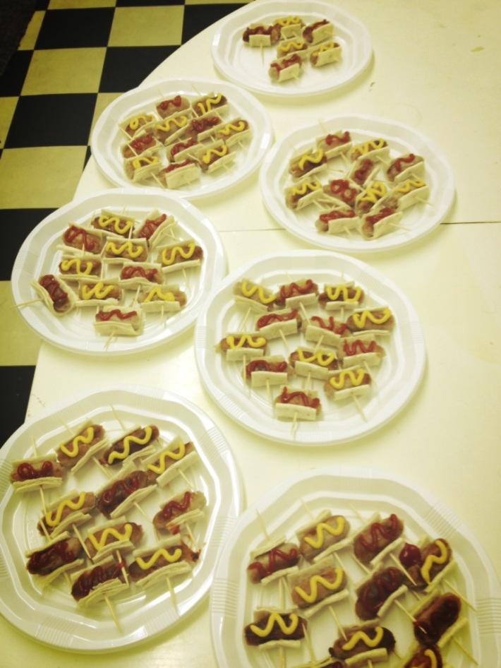 Some tiny hot dogs for our opening night crowd (complete with expert mustard and ketchup squiggles)